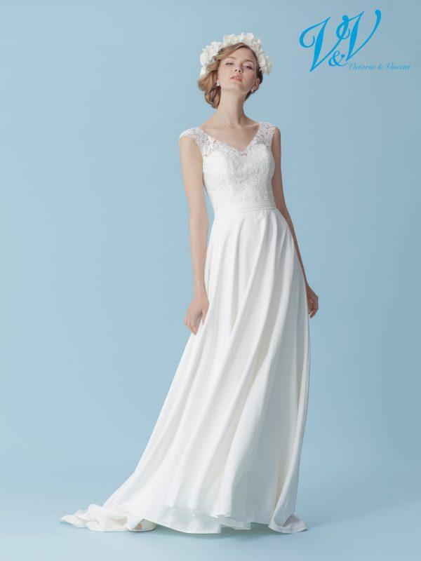 Ein Krepp-Hochzeitskleid für einen schlichten Bohemian-Look. Perfekt für eine Strandhochzeit.