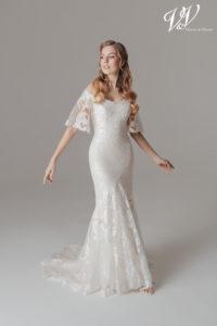 Ein schulterfreies Hochzeitskleid mit schönem Illusion-Rücken aus Spitze. Perfekt für eine Vintage-Optik.